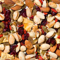 Repeating fruit and nut background healthy mixed dried nuts seamless tileable Stock Image