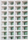 Repeating pattern of windows and balcony. Royalty Free Stock Photo