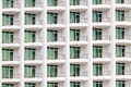 Repeating pattern of windows and balcony. Bulding front Royalty Free Stock Photo