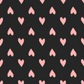 Repeating pink hearts on black background. Cute seamless pattern. Royalty Free Stock Photo