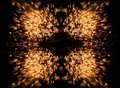 Repetitive firework pattern golden on black background Stock Photos