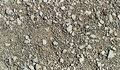 Repetitive pattern stones and gravel of ground made of grainy small granular Stock Photography