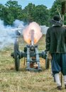 English Civil War Cannon Firing, Spetchley Park, Worcestershire, England. Royalty Free Stock Photo