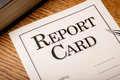 Report card close up of a on a desktop with a mechanical pencil and text book Royalty Free Stock Photos