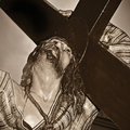 A representation of jesus christ carrying the holy cross Royalty Free Stock Photography