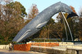 Reproduction of blue whale in ueno park tokyo two women take pictures a a full size this is settled close to national museum Stock Photos