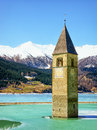 Reschenpass famous historic bell tower at the italy Royalty Free Stock Photo
