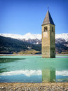 Reschenpass famous historic bell tower at the italy Royalty Free Stock Images