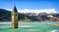 Reschenpass famous historic bell tower at the italy Stock Images