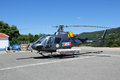 Rescue helicopter sitting on the landing pad in monchique portugal summer months monchique is on high alert for forest fires so a Royalty Free Stock Photography