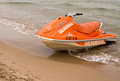 Rescue jet ski boat orange on a beach on the costa blanca in the province of alicante spain Royalty Free Stock Photo