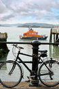 Rescue lifeboat in cobh with bicycle harbour county cork ireland foreground chained to post Stock Images