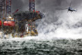 Rescue mission a helicopter landing on oil rig Stock Photos