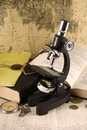 Research concept - microscope and books Stock Photo