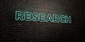 RESEARCH -Realistic Neon Sign on Brick Wall background - 3D rendered royalty free stock image Royalty Free Stock Photo
