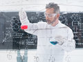 Researcheranalyzing substances close up of scientist conducting a chemical laboratory experiment with colorful liquids and a Stock Images