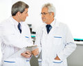 Researchers shaking hands male in hospital Royalty Free Stock Photo