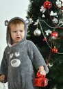 Resentful boy near new-year tree Royalty Free Stock Photo