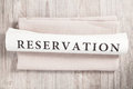 Reservation written on a newspaper Royalty Free Stock Photo