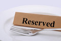 Reserved closeup shot of dining table with fork and plate Royalty Free Stock Images