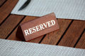 Reserved closeup shot of wooden sign Royalty Free Stock Photo