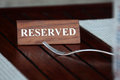 Reserved closeup shot of wooden sign Stock Photos