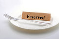 Reserved dining table with fork and plate Stock Photo