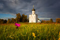 Reserved meadow near church of the intercession of the holy virgin on nerl river before a rain Stock Photos