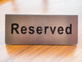 Reserved sign close up on table Royalty Free Stock Images
