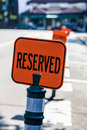 Reserved sign orange on street Royalty Free Stock Photo