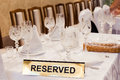 Reserved sign on the table in a fancy restaurant Royalty Free Stock Image