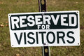 Reserved for visitors sign seen by the landmark Stock Photos