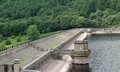 Reservoir earth dam the stone built top of a large Royalty Free Stock Photo