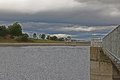 A reservoir view looking across with darkening clouds moving in from the west with water tower in foreground Stock Photos