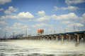 Reset of water at hydroelectric power station on the river Stock Photos