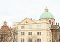 Residence of order of the cross with st francis assisi church behind in prague czech republic Stock Photography