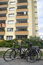 Residential area in berlin two bicycles are parked a street of front of a Stock Photography