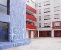 Residential building facade in white blue and red tone horizontal Royalty Free Stock Images
