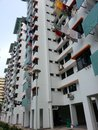 Residential building with laundry hanging out of window singapore Royalty Free Stock Photo