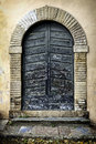 Residential doorway in lucca tuscany italy wooden Royalty Free Stock Photo