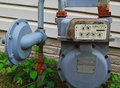 Residential gas meter natural gauge outside house Stock Photo