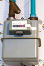 Residential gas meter of usual diaphragm style on home flat Royalty Free Stock Photography