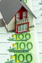 Residential house on bills banknotes symbolic photo for home purchase financing building society Stock Image