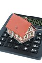 Residential house on calculator building a symbolic photo for home purchase costs and savings Stock Photo