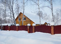 Residential house in the winter forest Royalty Free Stock Photo