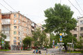 Residential houses, tree and people in Moscow 13.07.2017
