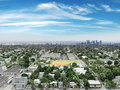Residential neighborhood with commercial and cityscape background a blue sky Stock Photos