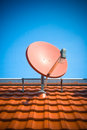 Residential satellite dish Stock Images