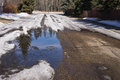 Residential street spring snow melt down Royalty Free Stock Photo