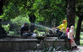 Residents relax in the park under a statue partini balaikambang tuin solo central java indonesia balekambang built by kgpaa Royalty Free Stock Photography
